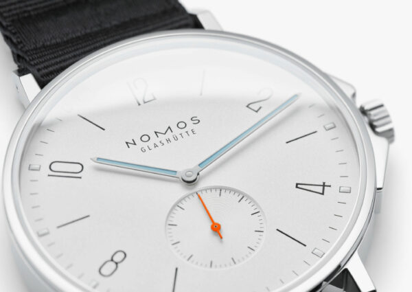 image of watch with white dial face and light blue hands