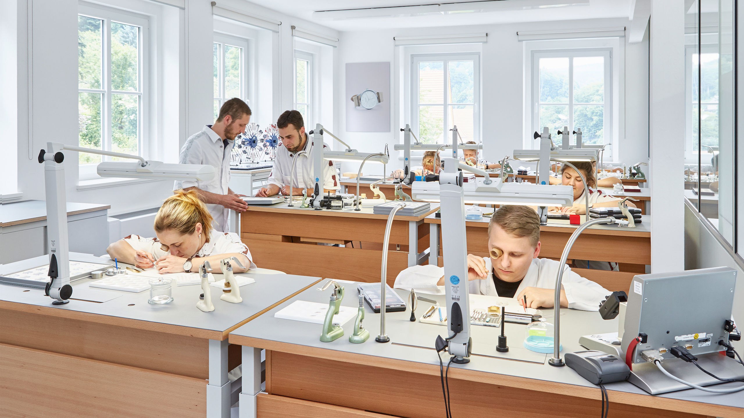 Image of people working in a watch making work space